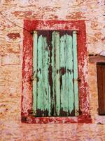 Rustic Window with Green Shutters in Crete, Greece