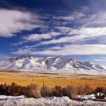 """snowy mountain near gsnm north of great salt lake"" by houstonryan"