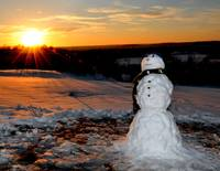 First Snowman at Sunset