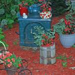 """Garden with Iron Stove"" by lwoodburn"