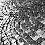 """Cobblestone pavement after rain"" by kingafoto"