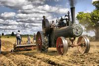 Steam tractor with plow
