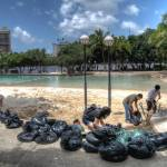 """""""Locals Filling Sand Bags at South Bank 2011 Floods"""" by urban"""