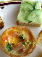 Miniature quiche and cucumber sandwich