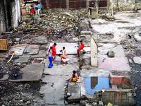 playing in ruins, manila - 2004