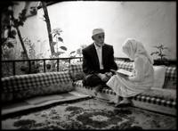 Girl reading the Koran with her teacher