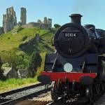 """Corfe castle and train in dorset"" by markconnell"