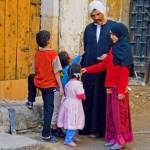 """Muslim father greets his children"" by ChristopherByrd"