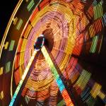 """Ferris Wheel in Motion"" by raetucker"