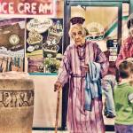 """Mardi Gras Grandma at Ice Cream Shop"" by AverytPhotography"