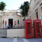 """Red Telephone Boxes in Valletta"" by MagieL"
