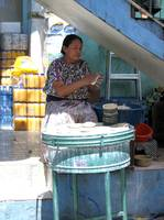 Guatemalen woman making tortillas