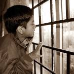 """Rain, Rain, Go away...........My son at Ooty."" by AroonKalandy"