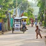 """Happy Filipino Street Scene"" by lightningman"