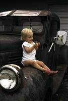 Little Child on Old Car