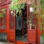 """Red decorative doors in Hangzou garden"" by JoEllis"