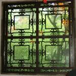 """Decorative window in Suzhou, China"" by JoEllis"