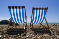 Deckchairs on the beach, Brighton, Susex, England.