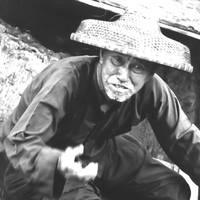 Chinese boatman 1976 showing begging hand movement