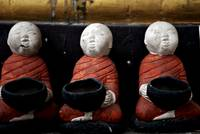 Monk statues with begging bowls (Colour)