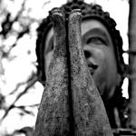 """Buddha with Folded Hands (B&W)"" by ThroughMyEye"