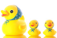 Three yellow ducks (toys).
