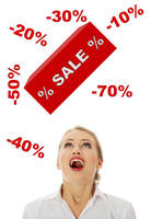 Young woman amazed because of sale.