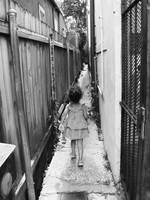 child running through alley