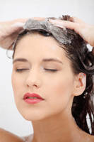 Beautiful young woman washing her hairs.