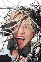 Mature businesswoman's screaming in cables..