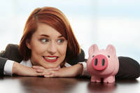 Businesswoman with her piggy bank.