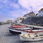 """Fishing Boats on pebbled beach"" by Countryside-Photos"