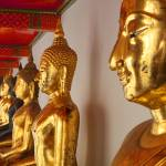 """Row of Buddha"" by travelbug"