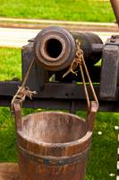 wooden cannon and water bucket