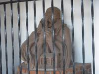 Statue behind wrought Iron bars