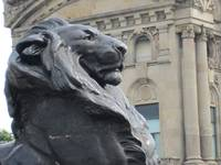 A lion at the base of the Estatua de Colon