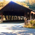 """Covered Bridge in the Autumn Forest"" by MachImagery"