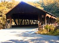 Covered Bridge in the Autumn Forest