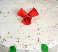 Christmas cake with red flower bells