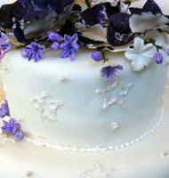 White wedding cake with lavender flowers