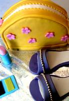 Yellow purse, purple stiletto, pink lipstick cake