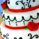 """White wedding cake with red trim"" by CakeQueen"