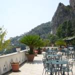 """Cafe on Amalfi Cliff Side"" by tararichter"