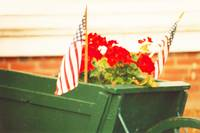 American Flags & Geraniums In A Wheelbarrow, Two