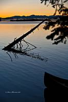 Leigh Lake Sunrise with Canoe Tip. verticle
