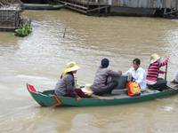 Delivery a tv in floating villages in Cambodia