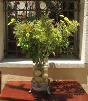 Traditional Greek floral arrangement in Santorini