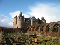 Gardens and medieval castle in autumn.
