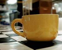 Yellow Coffee Cup At Cafe'