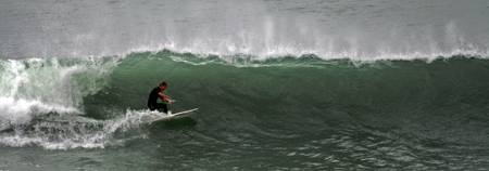A Surfer surfing, Raglan, New Zealand